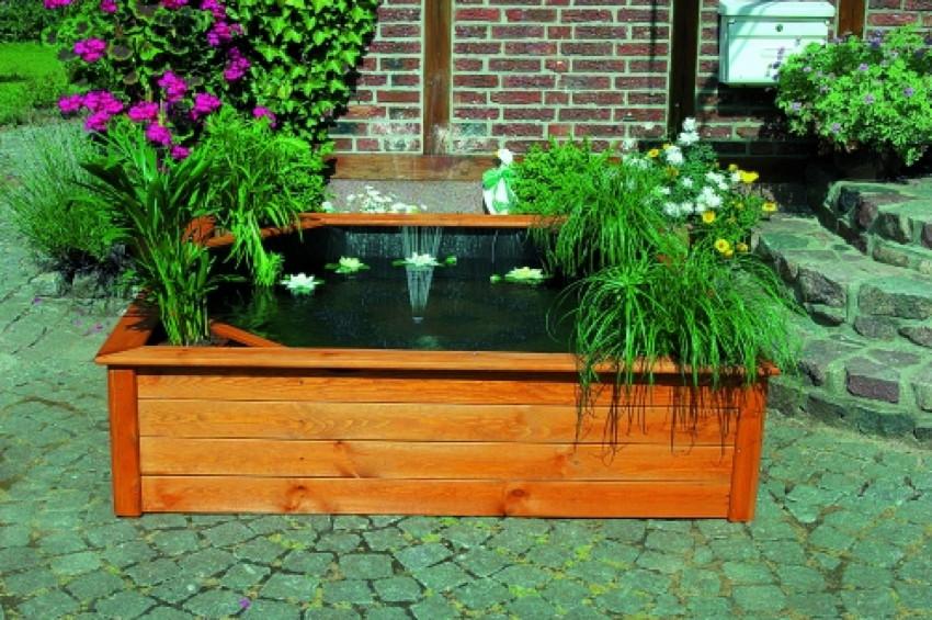 gartenteich promadino hochteich wasserspiel holzbrunnen. Black Bedroom Furniture Sets. Home Design Ideas